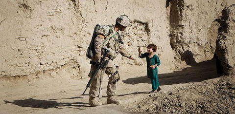 Soldier giving a child a high five